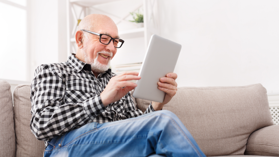 Elderly man using an iPad