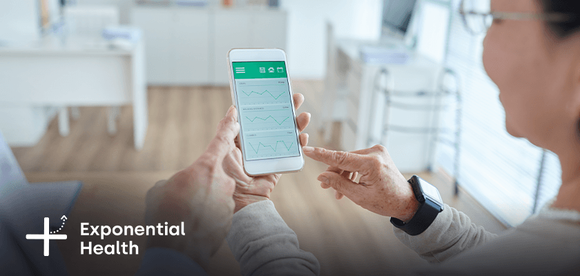 Patient and doctor looking at healthcare app on phone