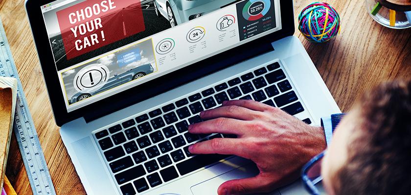 Man purchasing a car on a laptop
