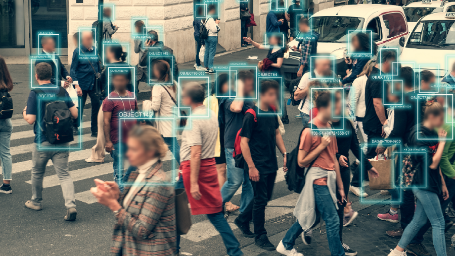 Face detection software highlighting people's faces on the street