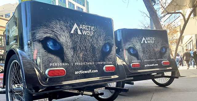 Two Arctic Wolf branded pedicabs outside of RSA 2020