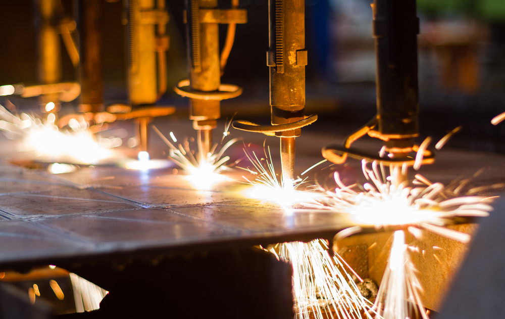 Sparks from a machine inside of a manufacturing assembly line.