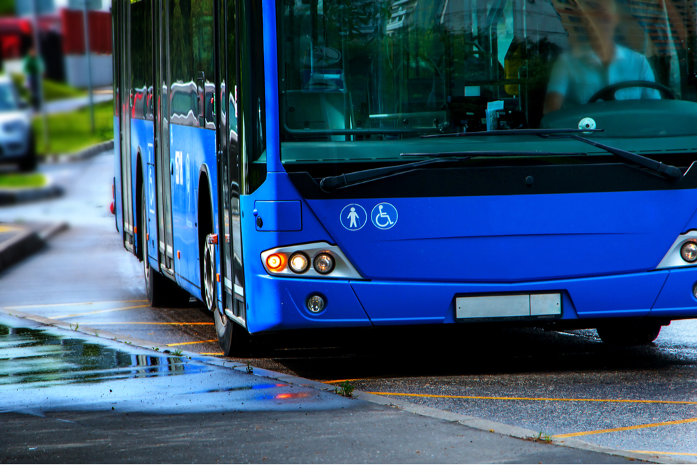The transportation industry isn't immune from the sights of hackers. A large blue city bus waits to pick up passengers.