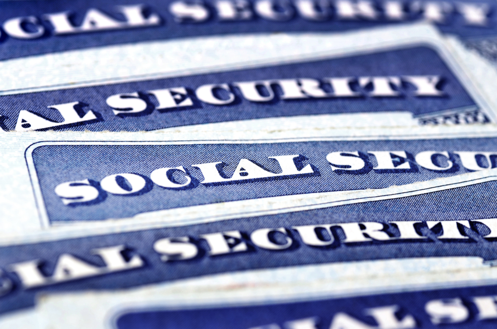 Social security cards stacked on top of each other. Social security numbers are prime targets in smishing attacks