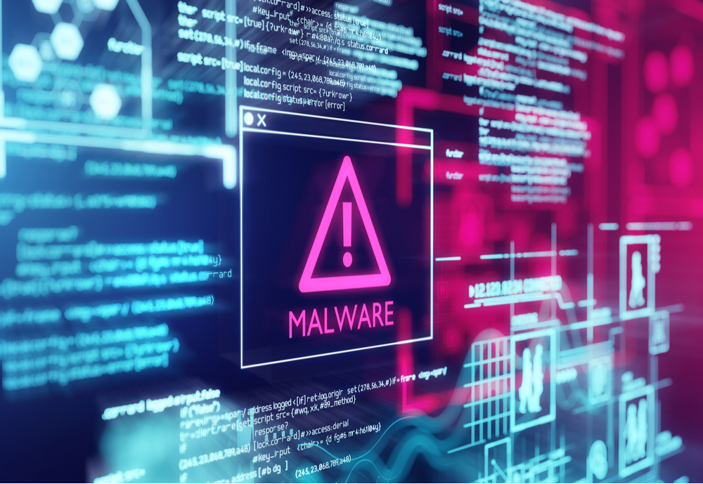 """A computer screen with an error exclamation point and """"Malware"""" written"""