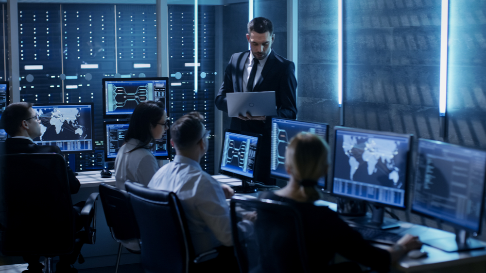 A cybersecurity team in a data center.