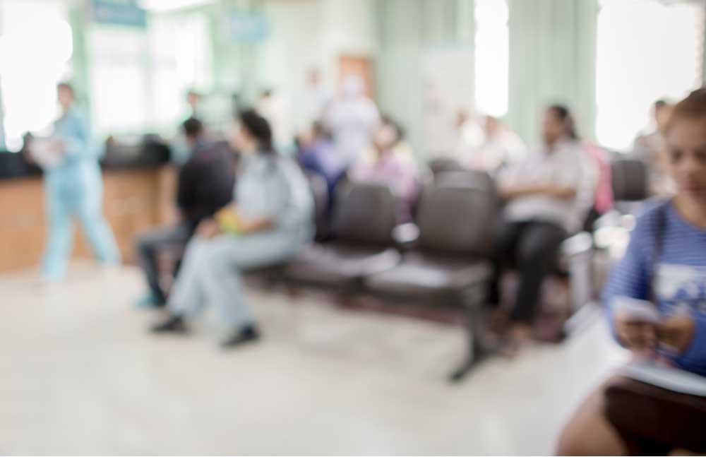 Inside of a hospital waiting room. Out of focus look at people waiting.