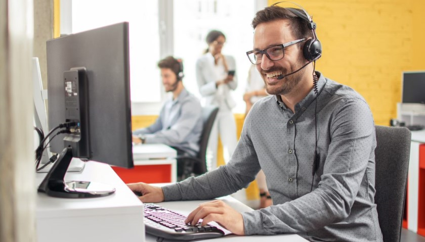 Man laughing with headset on