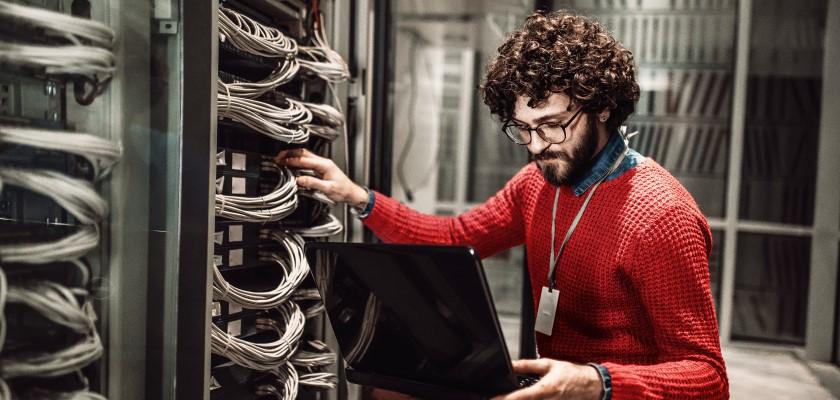 Man looking at servers