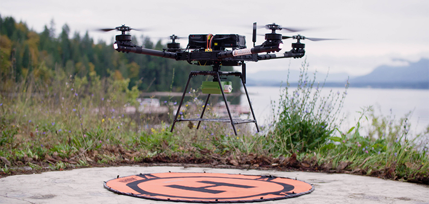 Drone flying over landing pad