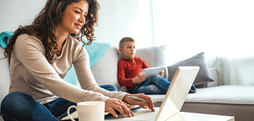 Mother and child working on laptop