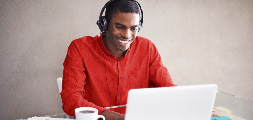 Man on laptop with headset