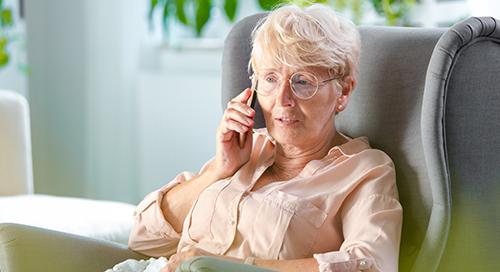 Elderly woman receiving telehealth services.
