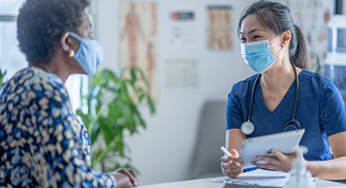 Health provider consulting with patient
