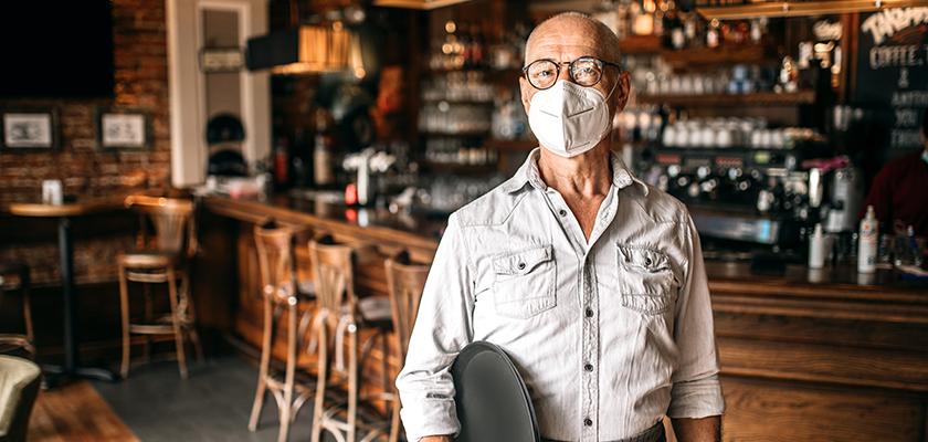 Mature bar server wearing a mask
