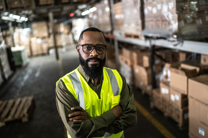 A millennial aged worker in a warehouse