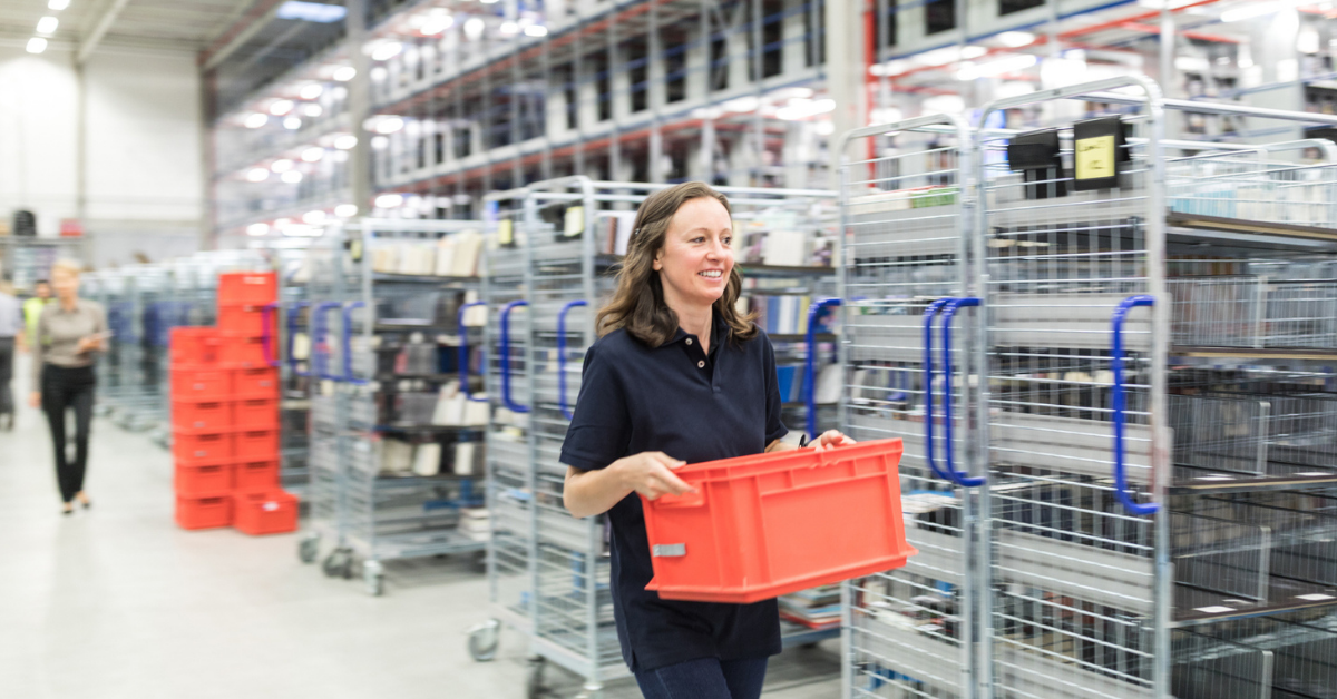 A warehouse worker who was recruited by a staffing company carrying a tote