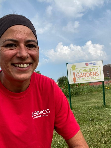 SIMOS recruiter Susan Yoakam volunteers at the community garden in Findlay, Ohio, helping harvest produce for families in need