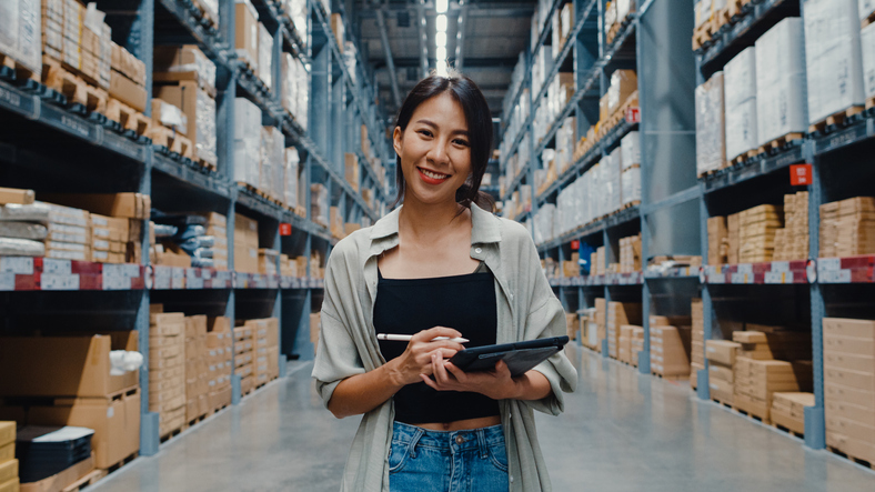 A woman in a warehouse who has learned the art of staff retention