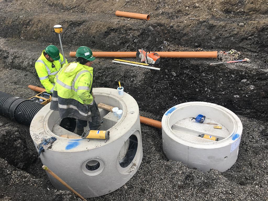 Maverick workers using trimble construction surveying equipment