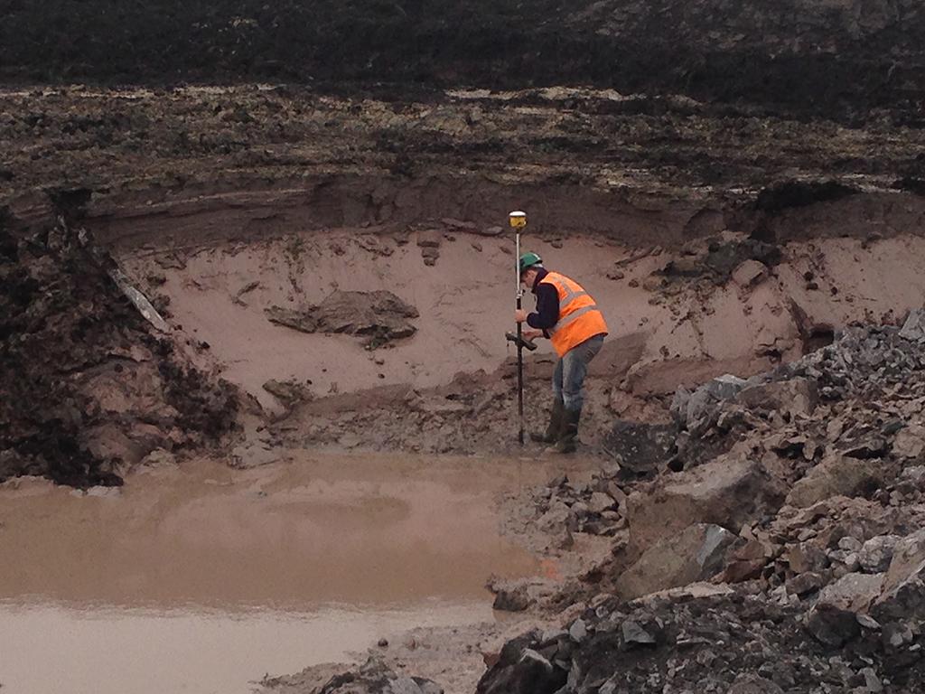 Maveric workers using trimble construction surveying equipment