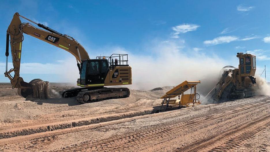 excavator and trenching machine working
