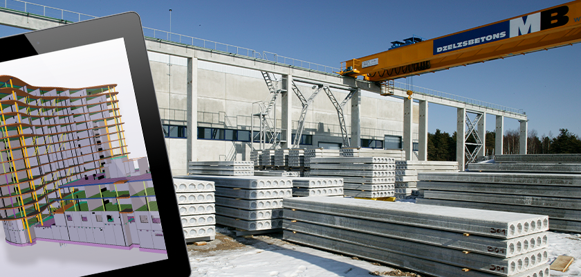 Tablet shows 3D BIM model of precast structure, in background precast floor section lay piled at production facility