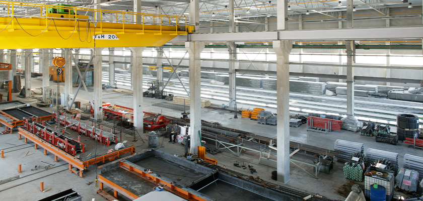 View looking down at precast concrete production line