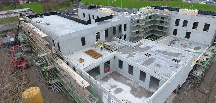 Looking down on construction of precast school