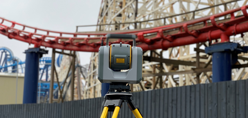 Trimble® SX10 in foreground pointed at The Big One roller coaster in the distance