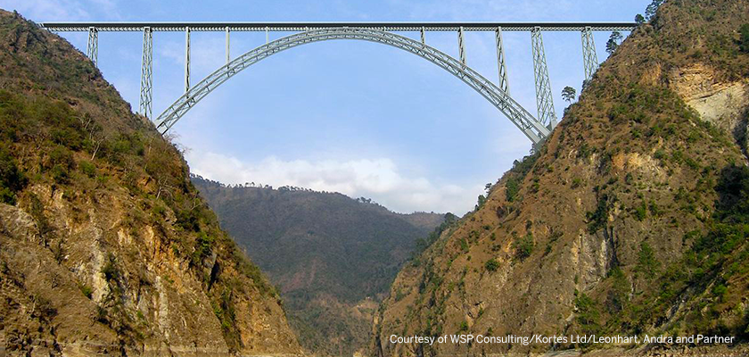 Side profile of Chenab Bridge upon completion, bridge towers across huge canyon