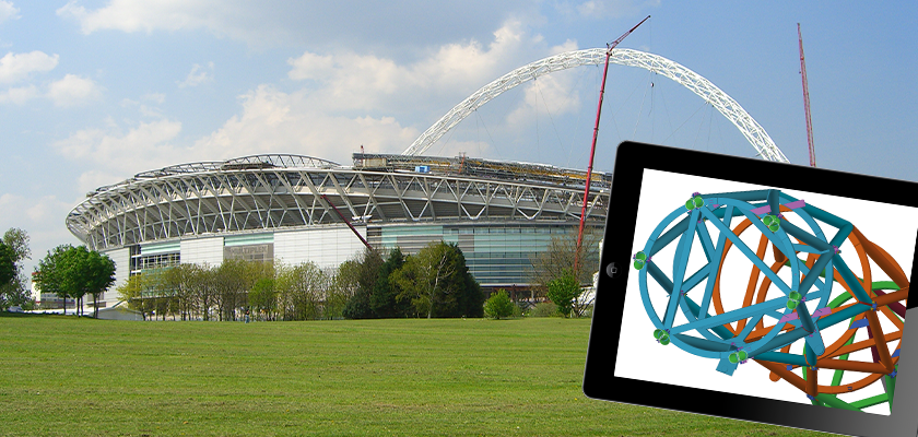 Wembley Stadium under construction with tablet showing 3D model of arch