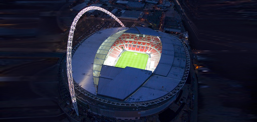 Night view of Wembley Stadium, the pitch and arch are lit-up
