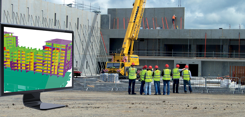 O'Reilly team stood together onsite in front of precast structruct