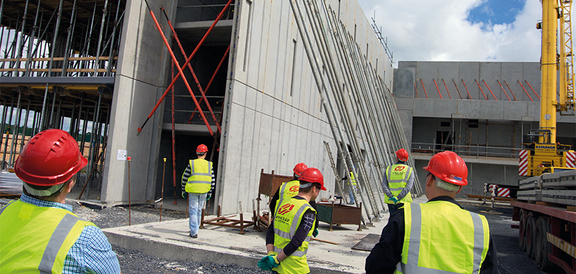 O'Reilly Concrete onsite, steel props are lined up against precast wall panels