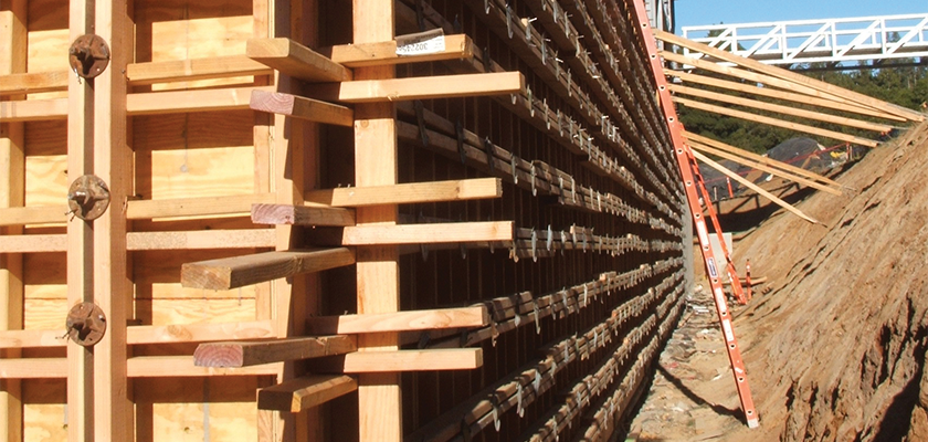 Onsite looking down a length of formwork with props