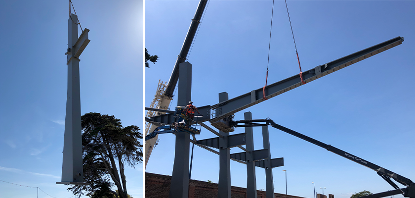 Crane positioning columns and cantilevered arms into place