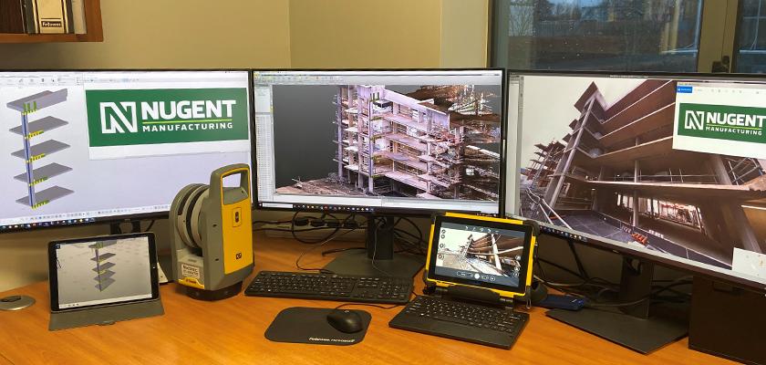 Desktop with three monitors showing Tekla Structures model. The desktop has a Trimble X7 Laser Scanner on it.