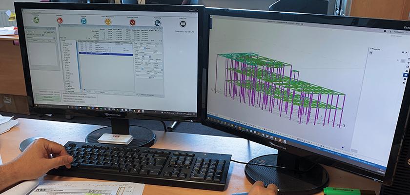 two monitors showing Tekla PowerFab generating estimates directly from model