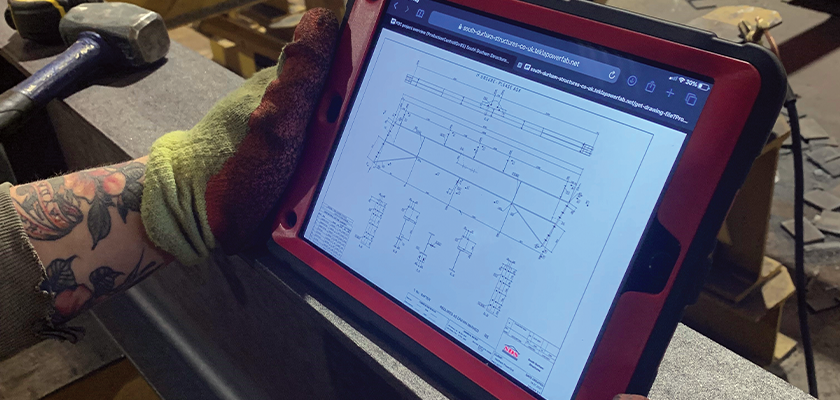 Through Tekla PowerFab, the fabricator accesses and views the drawing on their tablet