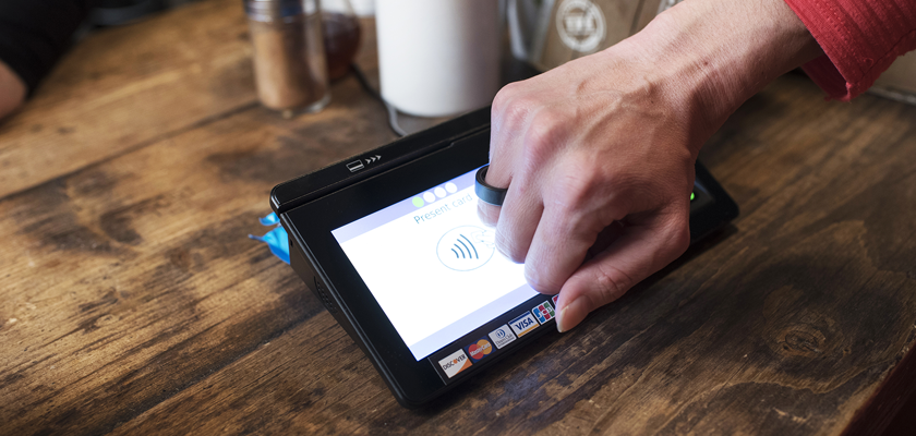Person paying with new ring technology