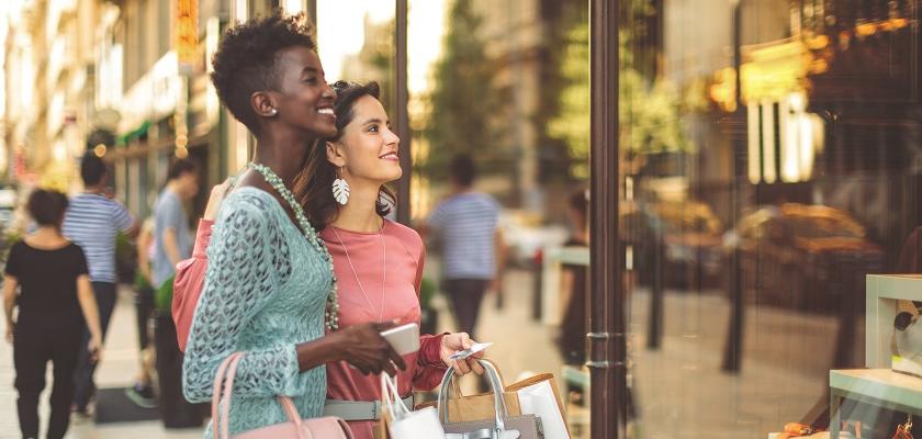 Two women window shopping in France