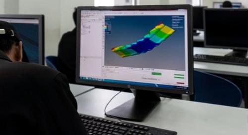 Designer using computer modeling.