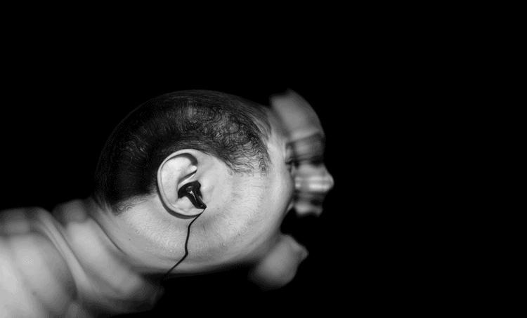 Man listening to a distorted sound