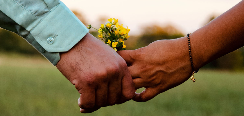 two people in relationship holding hands