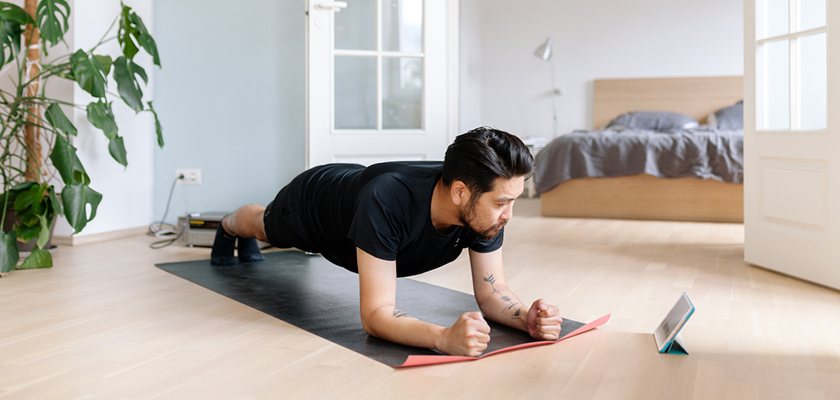 person working out at home as a new consumer habit