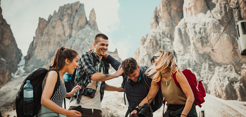 group of friends laughing while on a hike