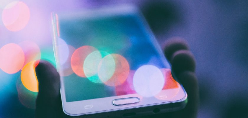close up of iPhone with colorful light glare reflection