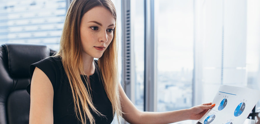 woman in office looking at social analytics insights