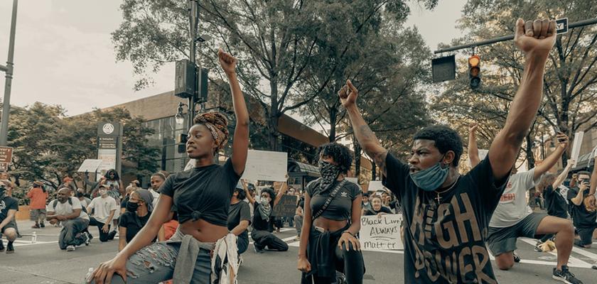people kneeling during Black Lives Matter protest